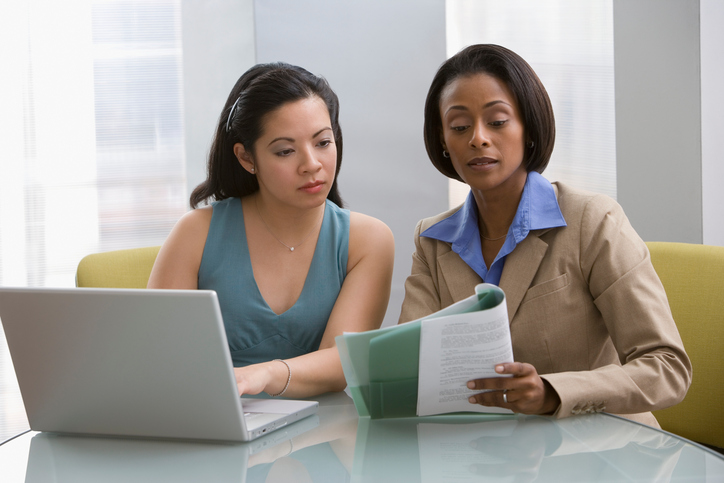 Multi Ethnic Businesswomen Discussing paperwork